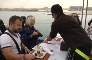 Dinner in the Sky hosts its guests 50 meters above the ground in a unique dining experience.(photo grabbed from Reuters video)