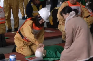 About 100 people participate in a disaster training drill in downtown Tokyo before the sixth anniversary of the Fukushima nuclear plant meltdown triggered by a massive earthquake and tsunami.(photo grabbed from Reuters video)
