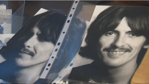 A vast collection of Beatles memorabilia, including albums, photographs and books, goes on auction in Paris.(photo grabbed from Reuters video)