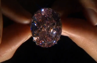 "A 59.60-carat diamond known as ""The Pink Star"" is returning to auction next month and could fetch a record $60 million, three years since it was sold for even more - only for the buyer to pull out of the deal.(photo grabbed from Reuters video)"