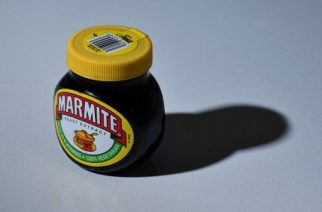 "A jar of Marmite is arranged for a photogaph in Brenchley, south east England, on October 13, 2016. British staple Marmite was taken off the virtual shelves at British supermarket Tesco on Thursday, following a reported row with supplier Unilever over pricing after the pound plummeted on fears over the UK's Brexit plans. Jars of Marmite were ""currently not available"" in the online store of Tesco -- the world's third biggest supermarket chain -- after the company reportedly refused Unilever's request to hike prices. / AFP PHOTO / BEN STANSALL"