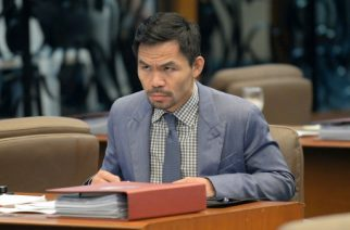 Philippine boxing icon and Senator Manny Pacquiao attends a senate session in Manila on February 13, 2017. Pacquiao on February 13 asked his legions of Twitter followers to choose his opponent after announcing his next world title defence will be in the United Arab Emirates. / AFP PHOTO / TED ALJIBE