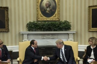 Translators watch as Egypt's President Abdel Fattah al-Sisi (L) and US President Donald Trump shake hands in the Oval Office before a meeting at the White House April 3, 2017 in Washington, DC. / AFP PHOTO / Brendan Smialowski
