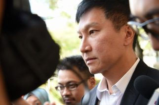 Kong Hee, the senior pastor of the City Harvest Church (CHC) leaves the Supreme court in Singapore on April 7, 2017. The leader of a rich Singapore Christian church was jailed more than three years on April 7 for misusing more than 35 million USD to promote his wife's failed music career. / AFP PHOTO / ROSLAN RAHMAN