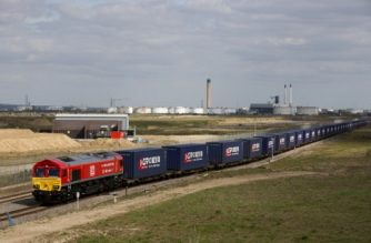 "A freight train transporting containers laden with goods from the UK, departs from DP World London Gateway's rail freight depot in Corringham, east of London, on April 10, 2017, enroute to Yiwu in the eastern Chinese province of Zhejiang. The first-ever freight train from Britain to China started its mammoth journey on Monday along a modern-day ""Silk Road"" trade route as Britain eyes new opportunities after it leaves the European Union. The 32-container train, around 600 metres (656 yards) long, left the vast London Gateway container port laden with whisky, soft drinks and baby products, bound for Yiwu on the east coast of China. / AFP PHOTO / Isabel Infantes"