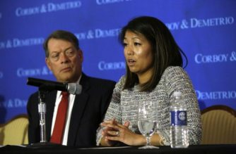 Crystal Dao Pepper (R), daughter of Dr. David Dao, pauses as she speaks about her father as she sits with her attorney Stephen Golan during a news conference on April 13, 2017 in Chicago, Illinois. Attorneys Thomas Demetrio and Golan are representing Dr. Dao after airport police officers physically removed him from his United Airlines seat and dragged him off the airplane at O'Hare International Airport during his flight from Chicago to Louisville, Kentucky, on April 9, 2017. / AFP PHOTO / Joshua LOTT