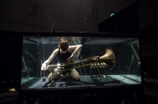 A member of the Between Music band, performs with a custom-made instrument in a glass water tank during a rehearsal ahead of the AquaSonic underwater concert on April 19, 2017 in Aarhus, Denmark. The AquaSonic underwater concert takes the audience on a unique and fascinating voyage into uncharted territory. The work presents five performers who submerge themselves in glass water tanks to play custom-made instruments and sing entirely underwater. Transformed inside these darkly glittering, aquatic chambers, they produce compositions that are both eerily melodic and powerfully resonant.  / AFP PHOTO / Jonathan NACKSTRAND