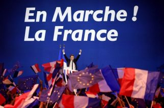 French presidential election candidate for the En Marche ! movement Emmanuel Macron waves at the audience during a meeting at the Parc des Expositions in Paris, on April 23, 2017, after the first round of the Presidential election. Centrist Emmanuel Macron and far-right leader Marine Le Pen emerged as the projected winners of a nail-biting first round presidential vote in France. / AFP PHOTO / Eric FEFERBERG