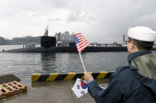 """In this image released by the US Navy shows the Ohio-class guided-missile submarine USS Michigan being greeted on April 25, 2017 as it arrives in Busan, South Korea, for a scheduled port visit while conducting routine patrols throughout the western Pacific.  The Michigan made a port call at Busan, while US navy destroyers carried out separate joint exercises with Japanese and South Korean vessels. According to the US Navy's Submarine Force Pacific website, the Michigan carries more than 150 Tomahawk cruise missiles. / AFP PHOTO / US NAVY / Jermaine RALLIFORD / RESTRICTED TO EDITORIAL USE - MANDATORY CREDIT """"AFP PHOTO / US NAVY / Mass Communication Specialist 2nd Class Jermaine Ralliford"""" - NO MARKETING NO ADVERTISING CAMPAIGNS - DISTRIBUTED AS A SERVICE TO CLIENTS"""