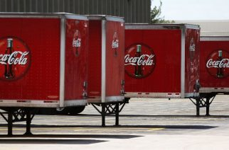 HOLLYWOOD, FL - APRIL 25: Coca Cola trucks are seen at a distribution center as the company announces plans to cut 1200 corporate staff jobs on April 25, 2017 in Hollywood, Florida. The announced changes come as the company battles a slide in soda sales which along with higher costs has lead to a 20 percent drop in quarterly profit.   Joe Raedle/Getty Images/AFP