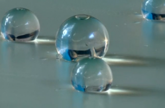 Ooho is an edible jelly-like sphere filled with drinkable liquid and made of natural, biodegradable materials that the makers hope could one day replace plastic bottles. (Photo grabbed from Reuters video)