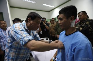 President Rodrigo Roa Duterte awards a Wounded Personnel Medal to First Lieutenant Jose Mari Landicho during his visit to Camp Teodulfo Bautista Station Hospital in Jolo, Sulu on April 6, 2017. ACE MORANDANTE/Presidential Photo