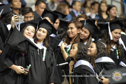 Happy time to take a selfie/groupie.  An NEU graduate takes a selfie with her friends at the Philippine Arena during the NEU's 42nd commencement exercises on Tuesday, April 18, 2017.  (Photo courtesy NEU official facebook page)