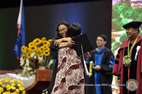 Happy day to be grateful about.  One of the touching scenes at the 42nd NEU graduation ceremonies.  NEU President Dr. Nilo Rosas can be seen in this photo (Photo courtesy NEU official facebook page)