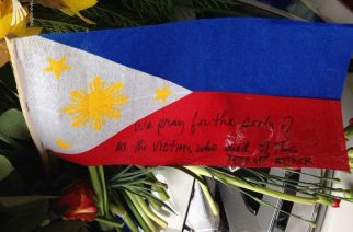 A Philippine flag is among those placed in the area where the victims of the Sweden truck attack are remembered with flowers and notes.  (Photo by Fritzie Joy, Eagle News Service)