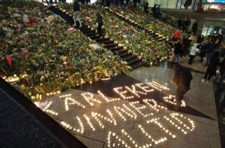 Mourners lay flowers, put candles at the scene of the Stockholm terror truck attack in the shopping district of Drottninggatan.  Photo from  Celma Mariano, Eagle News Service)