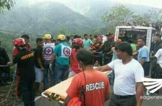 Rescuers try to save those injured in the bus accident in the northernmost town of Nueva Ecija.  (Eagle News Service)