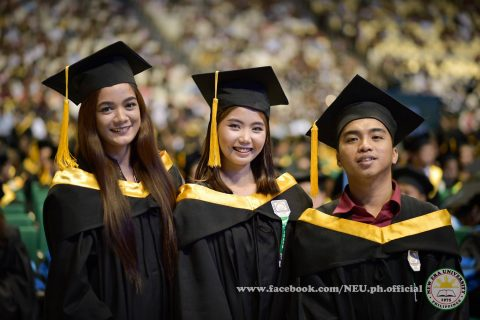 Happy day.  Three New Era University graduates pose for a photo during NEU's 42nd commencement exercises at the 55,000-seater Philippine Arena in Bocaue, Bulacan.  (Photo courtesy NEU official facebook page)