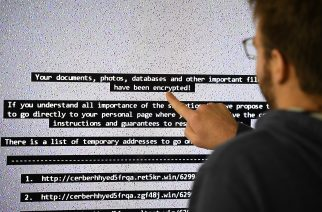"An IT researchers shows on a giant screen a computer infected by a ransomware at the LHS (High Security Laboratory) of the INRIA (National Institute for Research in Computer Science and Automation) in Rennes, on November 3, 2016. Paradise where computer viruses blossom under the watchful eye of scientists, the Laboratory of high security (LHS-PEC) of Rennes is a small fortress from where emerge the first studies on the ""ransomwares"", those digital brigands which Dominate the malware market. / AFP PHOTO / DAMIEN MEYER"