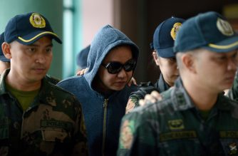 "Philippine businesswoman Janet Napoles (C) is escorted by police as she arrives the graft court for her arraignment in Manila on June 30, 2014. Napoles is at the heart of a massive corruption scandal involving three powerful legislators, Jose ""Jinggoy"" Estrada, Ramon Revilla and Juan Ponce Enrile. The case erupted last year when businesswoman Janet Napoles was accused of colluding with lawmakers to embezzle an estimated USD 230 million from legislator's ""pork barrel"" funds, or money for their pet projects. AFP PHOTO /POOL / NOEL CELIS / AFP PHOTO / POOL / NOEL CELIS"