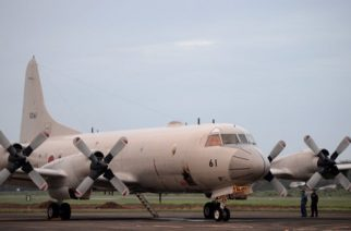A Japanese Maritime Self-Defense Force Lockheed P-3C Orion patrol aircraft is pictured on the tarmac before taking off as part of a joint training exercise with the Philippines, at Antionio Bautista Airbase in Puerto Princesa on the western Philippine island of Palawan on June 24, 2015. Japan and the Philippines flew patrol planes near disputed South China Sea waters for the second straight day on June 24, defying Chinese warnings. The Japanese P-3C Orion and a Philippine navy islander flew on a search and rescue drill 50 nautical miles (92.6 kilometres) northwest of Palawan island, officials said. AFP PHOTO / NOEL CELIS / AFP PHOTO / NOEL CELIS