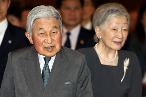 Japan's Emperor Akihito and Empress Michiko arrive for a meeting with family members of Japanese veterans living in Vietnam at a hotel in Hanoi on March 2, 2017. The 83-year-old Akihito and his wife, Michiko, are on their first visit to the country, the latest in a series of trips to former battlegrounds. / AFP PHOTO / POOL / MINH HOANG