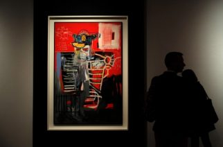 "A man looks at Jean-Michel Basquiat ""La Hara"" during Christie's press preview of the 20th Century Week, in New York on May 5, 2017.                          Christie's and Sotheby's are currently holding their Spring Auction previews. / AFP PHOTO / Jewel SAMAD / ""The erroneous mention[s] appearing in the metadata of this photo by Jewel SAMAD has been modified in AFP systems in the following manner: [Jean-Michel Basquiat  ""La Hara""] instead of [Cy Twombly's ""Leda and the Swan""]. Please immediately remove the erroneous mention[s] from all your online services and delete it (them) from your servers. If you have been authorized by AFP to distribute it (them) to third parties, please ensure that the same actions are carried out by them. Failure to promptly comply with these instructions will entail liability on your part for any continued or post notification usage. Therefore we thank you very much for all your attention and prompt action. We are sorry for the inconvenience this notification may cause and remain at your disposal for any further information you may require."""