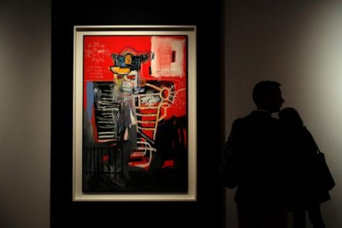 """A man looks at Jean-Michel Basquiat """"La Hara"""" during Christie's press preview of the 20th Century Week, in New York on May 5, 2017. Christie's and Sotheby's are currently holding their Spring Auction previews. / AFP PHOTO / Jewel SAMAD / """"The erroneous mention[s] appearing in the metadata of this photo by Jewel SAMAD has been modified in AFP systems in the following manner: [Jean-Michel Basquiat """"La Hara""""] instead of [Cy Twombly's """"Leda and the Swan""""]. Please immediately remove the erroneous mention[s] from all your online services and delete it (them) from your servers. If you have been authorized by AFP to distribute it (them) to third parties, please ensure that the same actions are carried out by them. Failure to promptly comply with these instructions will entail liability on your part for any continued or post notification usage. Therefore we thank you very much for all your attention and prompt action. We are sorry for the inconvenience this notification may cause and remain at your disposal for any further information you may require."""""""