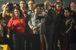 "Former Brazilian President Luiz Inacio Lula Da Silva, accompanied by former Brazilian President Dilma Rousseff (2nd-L), delivers a speech for folloers in Curitiba, Brazil, on May 10, 2017. Lula, backed by hundreds of red-shirted supporters, was due in court Wednesday for a corruption trial that could end his storied career. Lula, 71, is accused of receiving a seaside apartment as a bribe in a much wider corruption scheme investigated by the so-called ""Car Wash"" probe upending Brazilian politics. / AFP PHOTO / Instituto LULA / Heuler Andrey"