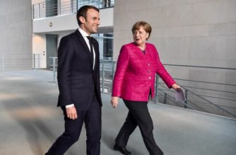 """French President Emmanuel Macron (L) and German Chancellor Angela Merkel (R) arrive for a press conference following talks at the Chancellery in Berlin on May 15, 2017. France's new President Emmanuel Macron secured backing from key ally Chancellor Angela Merkel for his bid to shake up Europe, despite scepticism in Berlin over his proposed reforms. Travelling to the German capital to meet the veteran leader in his first official trip abroad, Macron used the opportunity to call for a """"historic reconstruction"""" of Europe.  / AFP PHOTO / John MACDOUGALL"""