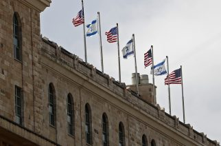 Israeli and US national flags are seen on top of the King David Hotel, where US President Donald Trump will be staying, in downtown Jerusalem, on May 19, 2017, three days ahead of his two day official visit in Israel and the Palestinian territories. / AFP PHOTO / THOMAS COEX
