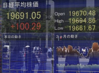 A stock quotation board displays share prices of the Tokyo Stock Exchange in front of a securities company in Tokyo on May 22, 2017.  Tokyo stocks opened higher on May 22, tracking gains on Wall Street last week as higher oil prices lifted energy shares. / AFP PHOTO / Kazuhiro NOGI
