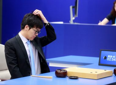 China's 19-year-old Go player Ke Jie reacts during the first match against Google's artificial intelligence programme AlphaGo in Wuzhen, east China's Zhejiang province on May 23, 2017. It's man vs machine this week from May 23 to 27 as Google's artificial intelligence programme AlphaGo faces the world's top-ranked Go player in a contest expected to end in another victory for rapid advances in AI. / AFP PHOTO / STR / China OUT