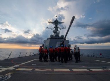 """US sailors receive a safety brief on the Arleigh Burke-class guided-missile destroyer USS Dewey prior to a replenishment-at-sea on May 6, 2017, in the South China Sea.  The USS Dewey sailed in disputed South China Sea waters near a reef claimed by Beijing, a US official said on May 24, 2017. Dewey sailed """"less than 12 nautical miles"""" from Mischief Reef, part of the the Spratly Islands, in a """"freedom of navigation operation,"""" the official said. It is Washington's first such exercise under the administration of US President Donald Trump.  / AFP PHOTO / US NAVY / Kryzentia Weiermann / RESTRICTED TO EDITORIAL USE - MANDATORY CREDIT """"AFP PHOTO / US Navy / Mass Communication Specialist 3rd Class Kryzentia Weiermann"""" - NO MARKETING NO ADVERTISING CAMPAIGNS - DISTRIBUTED AS A SERVICE TO CLIENTS"""
