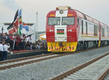 Kenyan President Uhuru Kenyatta flags off a cargo train as it leaves the container terminal at the port of the coastal town of Mombasa on May 30, 2017. More than a century after a colonial railway gave birth to modern Kenya, the country is betting on a new Chinese-built route to cement its position as the gateway to East Africa. The $3.2 billion (2.8 billion euro) railway linking Nairobi with the port city of Mombasa will May 31 take its first passengers on the 472 kilometre (293 mile) journey, allowing them to skip a hair-raising drive on one of Kenya's most dangerous highways.  / AFP PHOTO / TONY KARUMBA