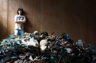"TO GO WITH AFP STORY BY NICOLAS DELAUNAY A handout photo released by the Dutch Organization ""The Ocean Cleanup"" on July 2, 2014 shows Dutch student Boyan Slat, 19, posing by a pile of garbage found in the sea, in October 2013 in Delft. Slat is only 19 years old, but he already has 100 people working on his revolutionary plan to scoop thousands of tonnes of damaging plastics from the oceans. The world's 'plastic soup', much of it swirling around in five main gyres or rotating oceanic currents, causes billions of euros (dollars) in damage every year.   AFP PHOTO / HO / THE OCEAN CLEANUP = RESTRICTED TO EDITORIAL USE - MANDATORY CREDIT ""AFP PHOTO / THE OCEAN CLEANUP"" - NO MARKETING NO ADVERTISING CAMPAIGNS - DISTRIBUTED AS A SERVICE TO CLIENTS = / AFP PHOTO / THE OCEAN CLEANUP / -"
