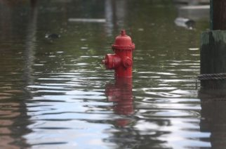 FORT LAUDERDALE, FL - SEPTEMBER 30: A fire hydrant is surrounded by water in a flooded street caused by the combination of the lunar orbit which caused seasonal high tides and what many believe is the rising sea levels due to climate change on September 30, 2015 in Fort Lauderdale, Florida. South Florida is projected to continue to feel the effects of climate change and many of the cities have begun programs such as installing pumps or building up sea walls to try and combat the rising oceans.   Joe Raedle/Getty Images/AFP