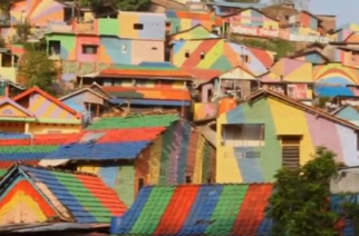 "Once considered a slum, Kampung Pelangi (pronounce as ""Com-has become a tourist attraction for local and international visitors following a colorful makeover.(photo grabbed from Reuters video)"