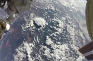 NASA released action camera video shot by astronauts on a spacewalk outside the International Space Station (ISS).(photo grabbed from Reuters video)