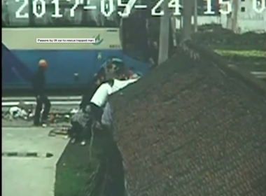 A car hit a tricycle at a crossroads in Haimen City of east China's Jiangsu Province on Wednesday, leaving the tricycle driver trapped underneath the car, as shown by footage from roadside monitoring cameras. Photo grabbed from Reuters video file.