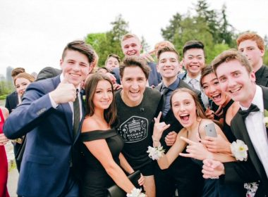 Canadian Prime Minister Justin Trudeau jogs through prom photos
