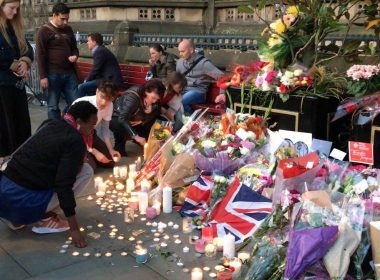 People bring flowers in tribute to the victims of the Manchester Arena blast that claimed young lives.  (Eagle News Service, EBC London Bureau photo)