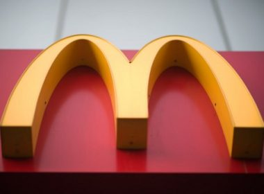 A McDonald's fast food restaurant sign is seen in Beijing on January 9, 2017. US fast-food giant McDonald's will sell a controlling stake in its China and Hong Kong business for up to 2.08 billion USD to a consortium including state-owned Citic and the Carlyle Group, it was announced on January 9.   McDonald's has ended its longtime Olympic sponsorship dating back to 1976, the International Olympic Committee announced on Friday./ AFP PHOTO / NICOLAS ASFOURI