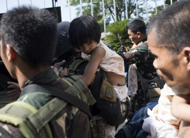 News in photos:  Children among those rescued by gov't troops as fighting continues in Marawi City