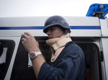 ABC journalist Adam Harvey wears a neckbrace as he is about to ride an ambulance at the Lanao Del Sur Provincial Capitol in Marawi, on the southern Philippine island of Mindanao on June 15, 2017.   A stray bullet hit Harvey's neck inside the Provincial Capitol. / AFP PHOTO / NOEL CELIS