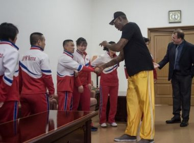 """Former NBA star Dennis Rodman (R) of the US greets North Korean athletes at the Pyongyang Indoor Stadium on June 15, 2017 Rodman arrived in the North Korean capital on June 13 on a mission he said he believed the US President would be """"pretty happy"""" about, adding he was trying to accomplish something that """"we both need"""".  / AFP PHOTO / KIM Won-Jin"""