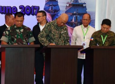 "This handout photograph taken and released by the Indonesian National Armed Forces on June 19, 2017 shows (front L to R) Indonesia's military chief Gatot Nurmantyo, Malaysia's armed forces chief Raja Mohamed Affandi, and Philippines' Chief of staff of the armed forces Eduardo Ano, (back L to R) Indonesia's minister of defence Ryamizard Ryacudu, Malaysia's minister of defence Hishammuddin Hussein, and Philippines' Secretary of National Defense Delfin Lorenzana, signing agreements for the ""trilateral coordinated maritime patrol"" in Tarakan, North Kalimantan.  Indonesia, Malaysia and the Philippines began joint naval patrols in their region on June 19 as threats from extremist groups increase. The ""trilateral coordinated maritime patrol"" was launched amid continuing battles between Philippine troops and Islamist gunmen loyal to the Islamic State group, who have seized part of the city of Marawi in the southern Philippine island of Mindanao. / AFP PHOTO / INDONESIAN NATIONAL ARMED FORCES / Handout / RESTRICTED TO EDITORIAL USE - MANDATORY CREDIT ""AFP PHOTO / INDONESIAN NATIONAL ARMED FORCES"" - NO MARKETING NO ADVERTISING CAMPAIGNS - DISTRIBUTED AS A SERVICE TO CLIENTS"
