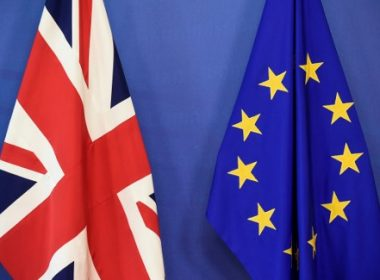 """A Union Jack (L) and a flag of the European Union are seen at the European Commission in Brussels on June 19, 2017, as Britain starts formal talks to leave the EU. Britain starts formal talks to leave the EU on Monday, seeking a deal """"like no other in history"""" despite entering fiendishly difficult negotiations with a badly weakened government. / AFP PHOTO / JOHN THYS"""