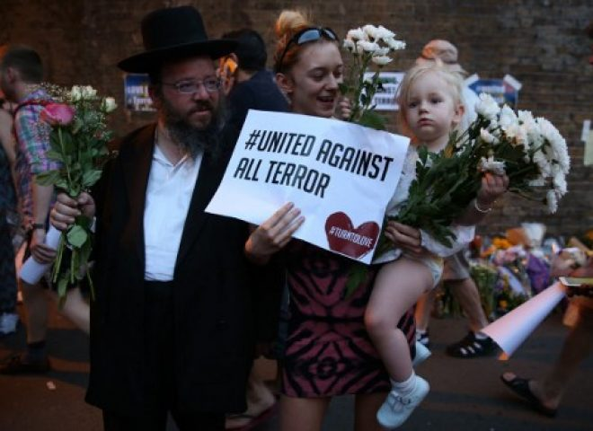 """News in photos:  """"United against all terror"""" – London residents attend vigil at scene of van attack"""