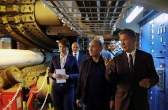 Russian President Vladimir Putin (C), accompanied by Gazprom Chief Executive Officer Alexei Miller (R), visits the Pioneering Spirit pipelaying ship in the Black Sea on June 23, 2017. Russian President Vladimir Putin on Friday launched the deep-water phase of the TurkStream gas pipeline project, calling Turkey's Recep Tayyip Erdogan from a ship off the Black Sea coast. TurkStream will deliver Russian gas to Turkey and is eventually intended to serve the European Union.  / AFP PHOTO / SPUTNIK / Mikhail METZEL